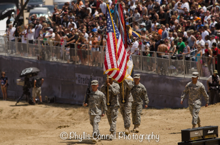 Soldiers entering with American Flag.